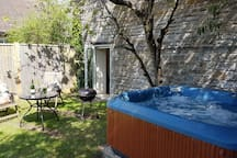Back garden with private tub and BBQ