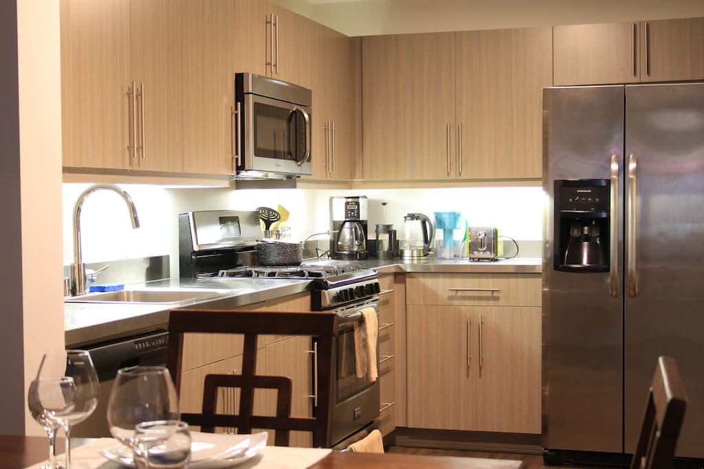 Comes with a fully equipped kitchen stocked with cooking utensils and high end appliances...everything you need for cooking.