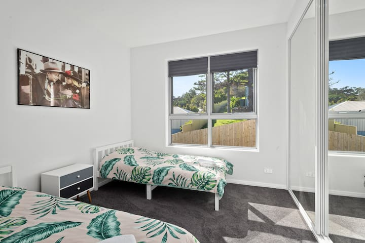 Bedroom 2 with 2 single beds that can be brought together to form a double.  Air conditioning has been installed in each bedroom (installed after photo taken).