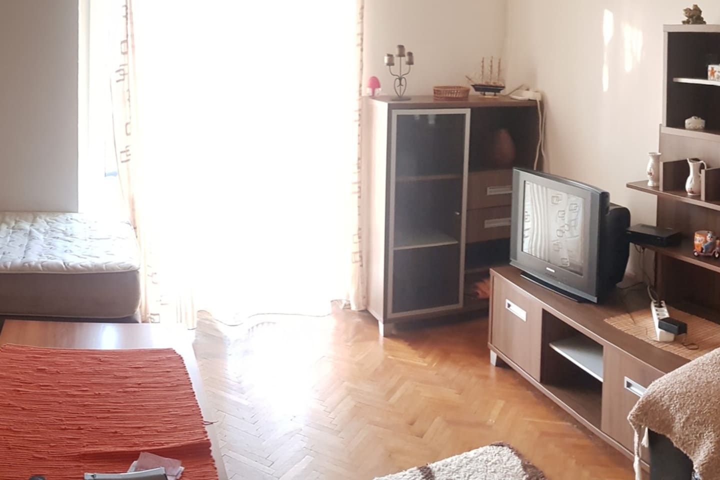 Very spacious living room with a large balcony. With cozy sofa for 2 people and one more for 1 person.