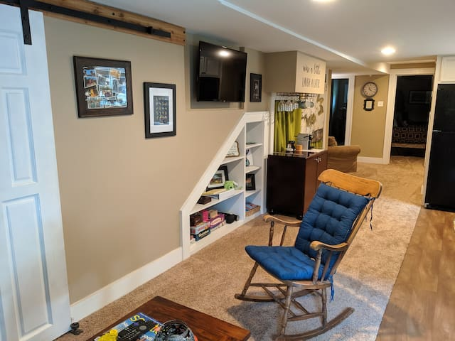Open living and kitchen areas with flat screen TV, coffee/wine bar, and plenty of board games.