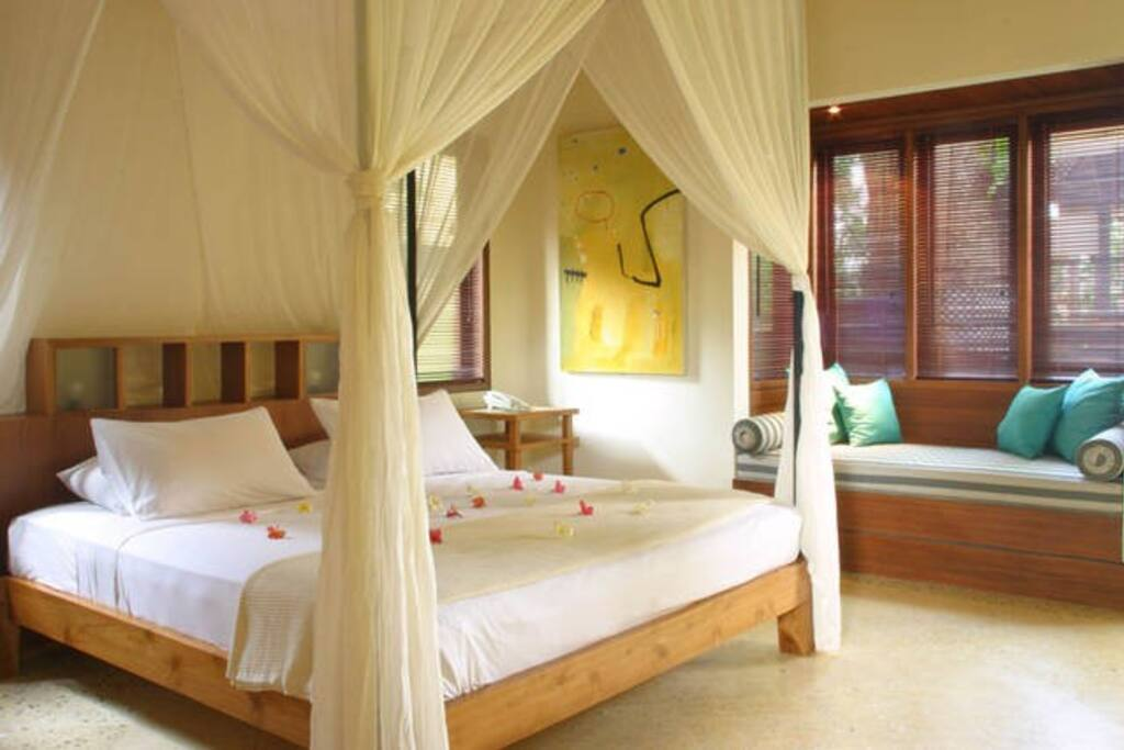 Luxury , air conditioned bedrooms with four poster, queen sized bed and daybed or children's bed.