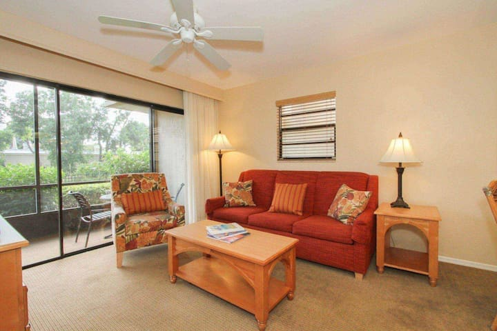 Bright and spacious living room w/queen sleeper sofa.