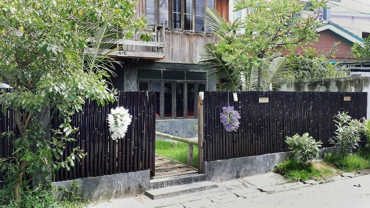 Teak house and tropical garden in city center