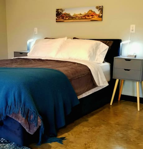 Queen size bed, plush comforter, nightstands with USB ports