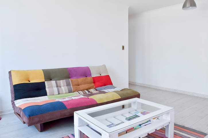 Comfy futon in the spacious living room