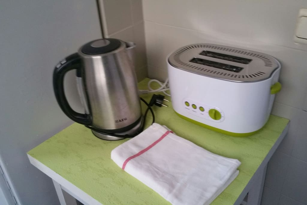 Kettle and toaster available in kitchen with microwave