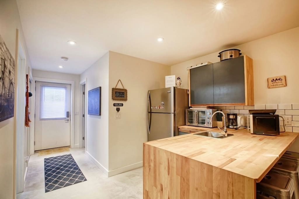 This kitchen should have what  you need to prepare and cook most anything. You can see the Main entrance and the washroom entry at the end of the hall