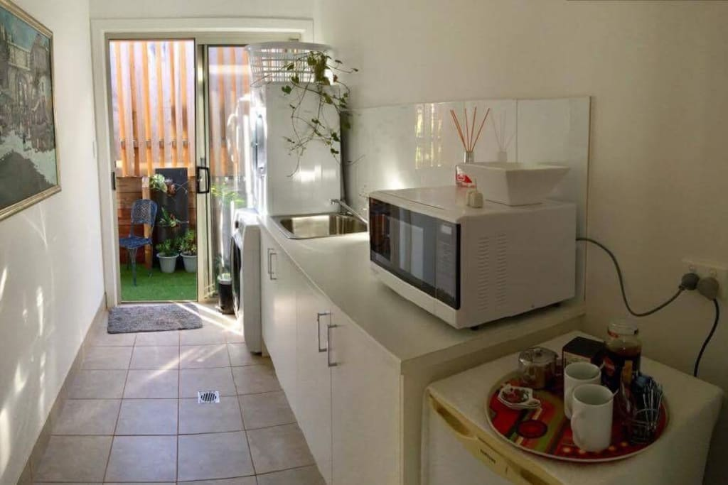 Private entrance through small Kitchen with Washer and dryer.