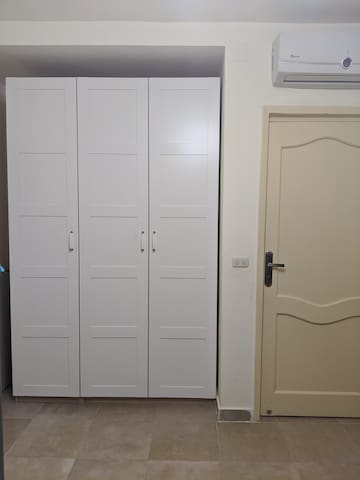 Second bedroom with 3 Ikea cupboard and an AC