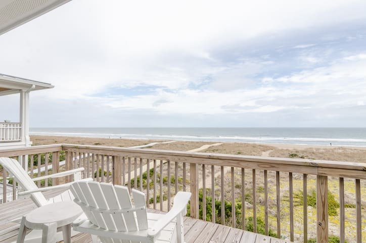 Smith and Young-Top floor oceanfront condo with community dock and boat slip
