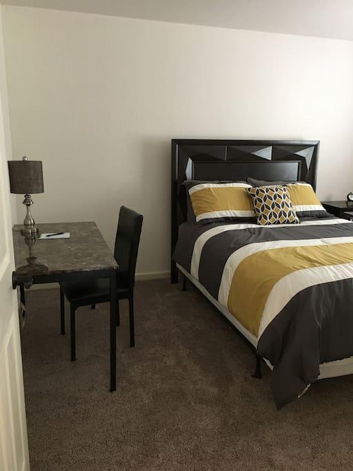 Master bedroom: queen bed with desk.