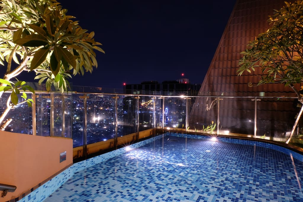Kids pool on the rooftop with the city view at dawn