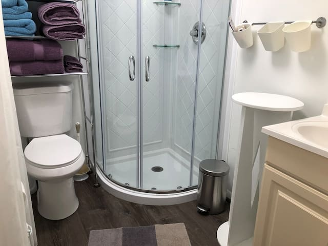 Private bath with shower, towels, bathrobes, soap, shampoo, hair dryer, and other amenities—all provided.  We use sensitive products—easy on you and the environment.