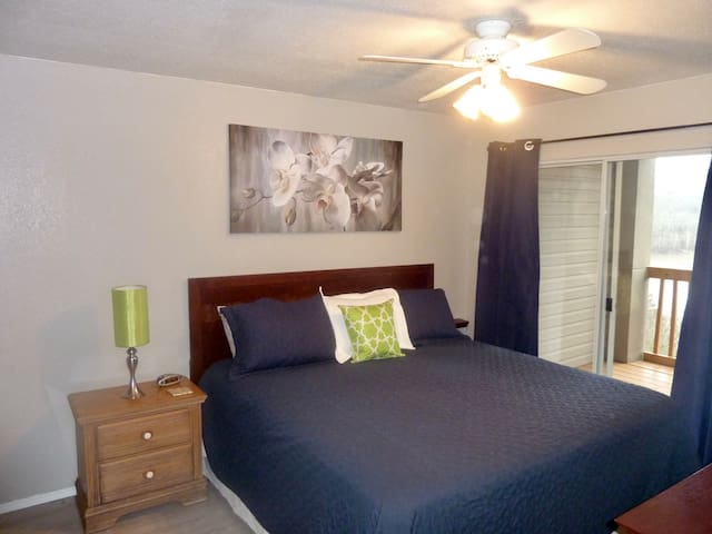 Master Bedroom with walkout to deck overlooking the lake.  King bed.