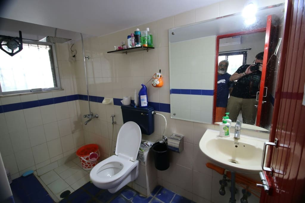Attached washroom with shower and toilet
