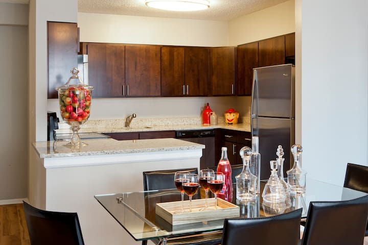 Stylish, functional kitchen, fully equipped with all necessities including tableware, silverware, pots and pans, dishtowels and more.