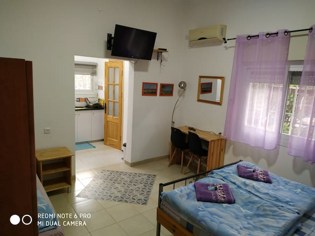 Double bed room and single bed . With toilet and shower , and kitchen .