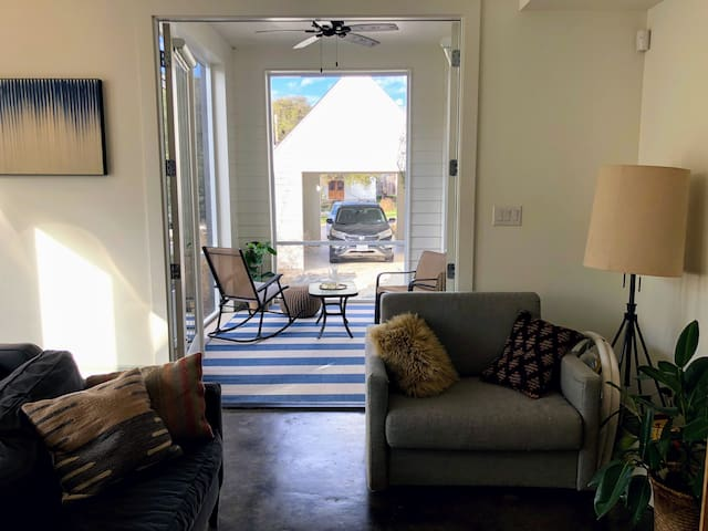 You can open the porch doors to enjoy fresh air while relaxing in our living room.