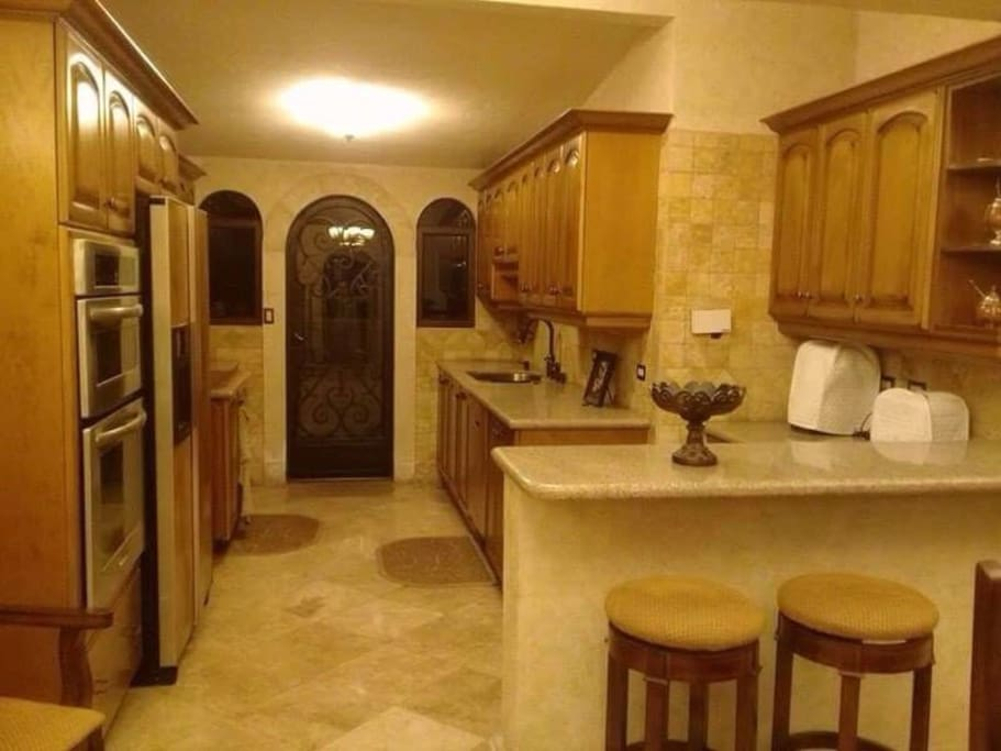 This kitchen is fully equipped with modern appliances, including dishwasher, and granite counter tops. Off the kitchen patio is the laundry room with a full washer and dryer.