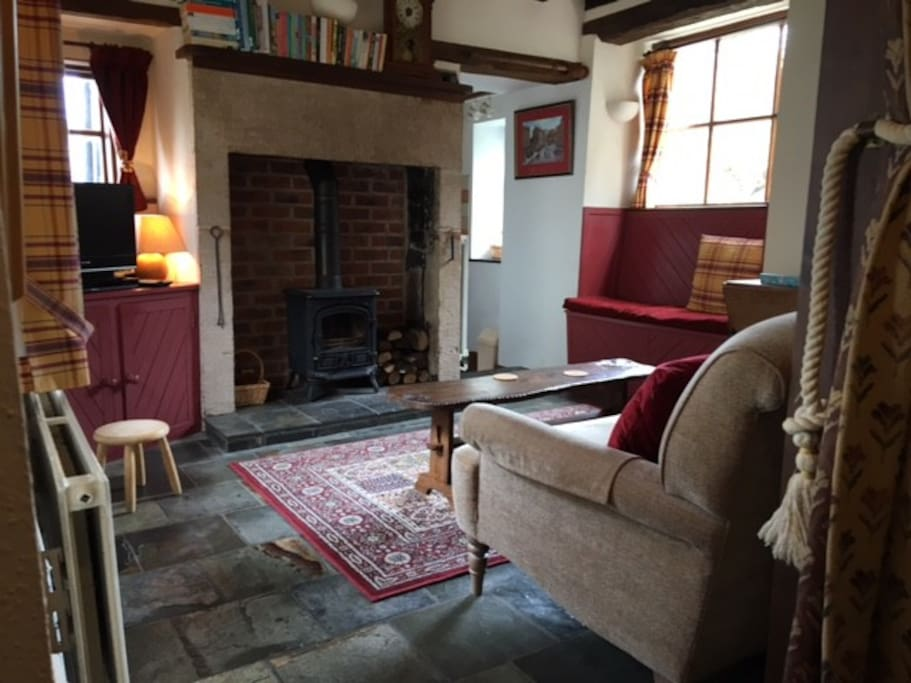 Cosy lounge with wood burning stove, satellite TV,  and sofa