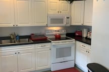 Full size kitchen with double sink and built in microwave