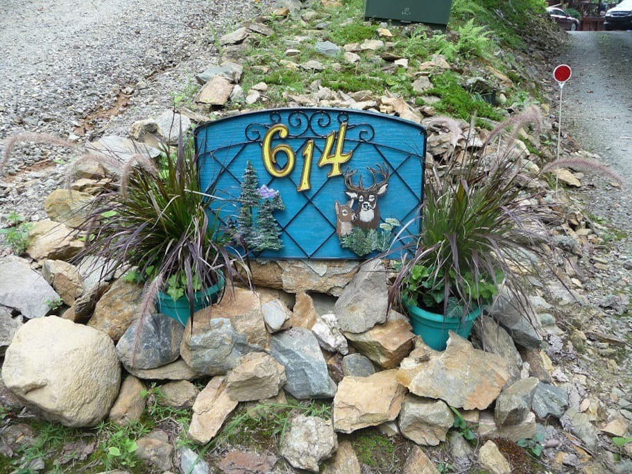 The first thing that you will see is the house number sign that my beautiful wife made by hand.