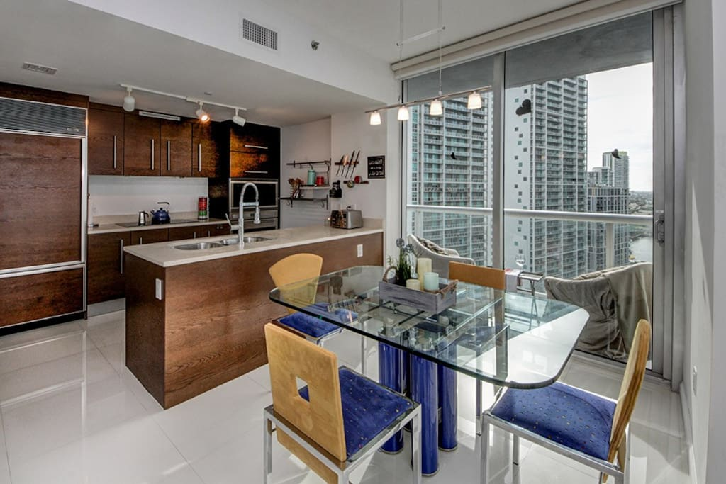 Dining table and kitchen.