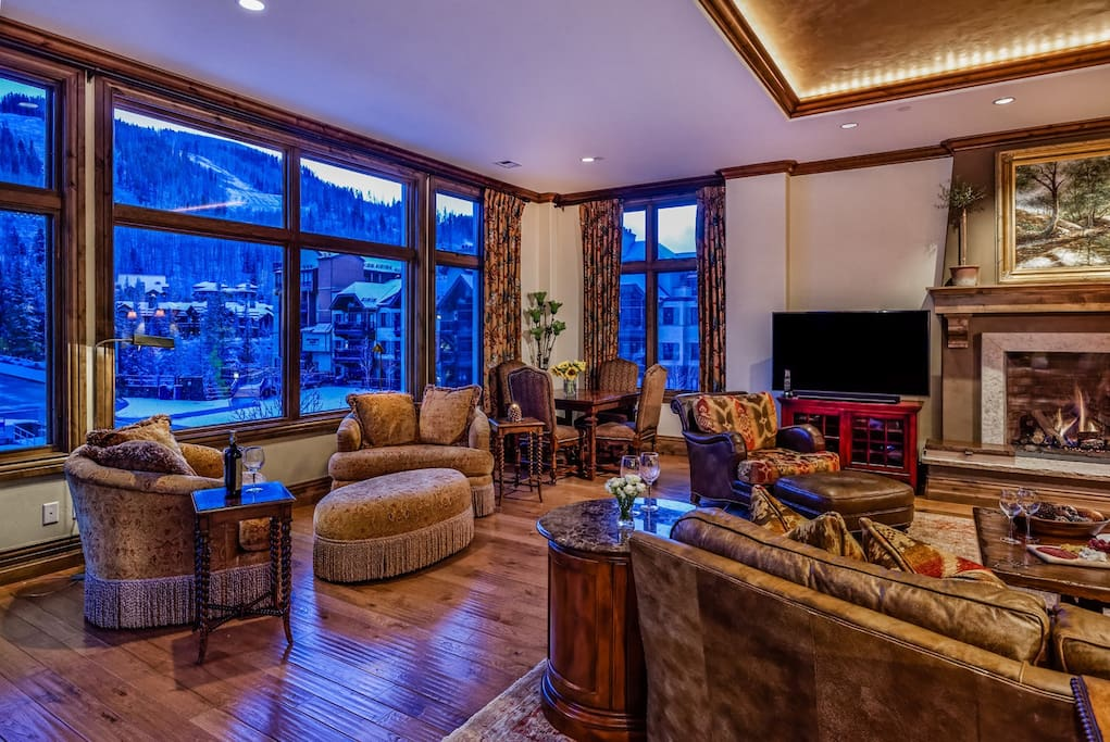 High tray ceilings and feature lighting add warm ambiance to your own chalet.