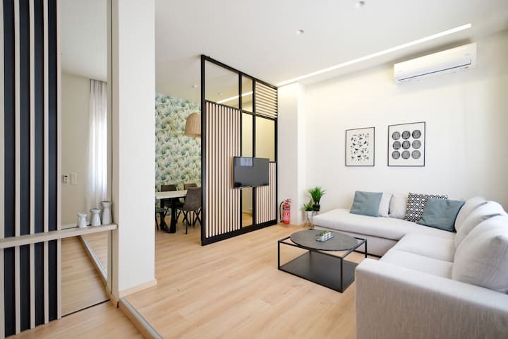 Welcome to Ourania! By the entrance of the apartment you will find a spacious living  area with a big corner sofa, a smart TV (Netfix ready) and a/c.