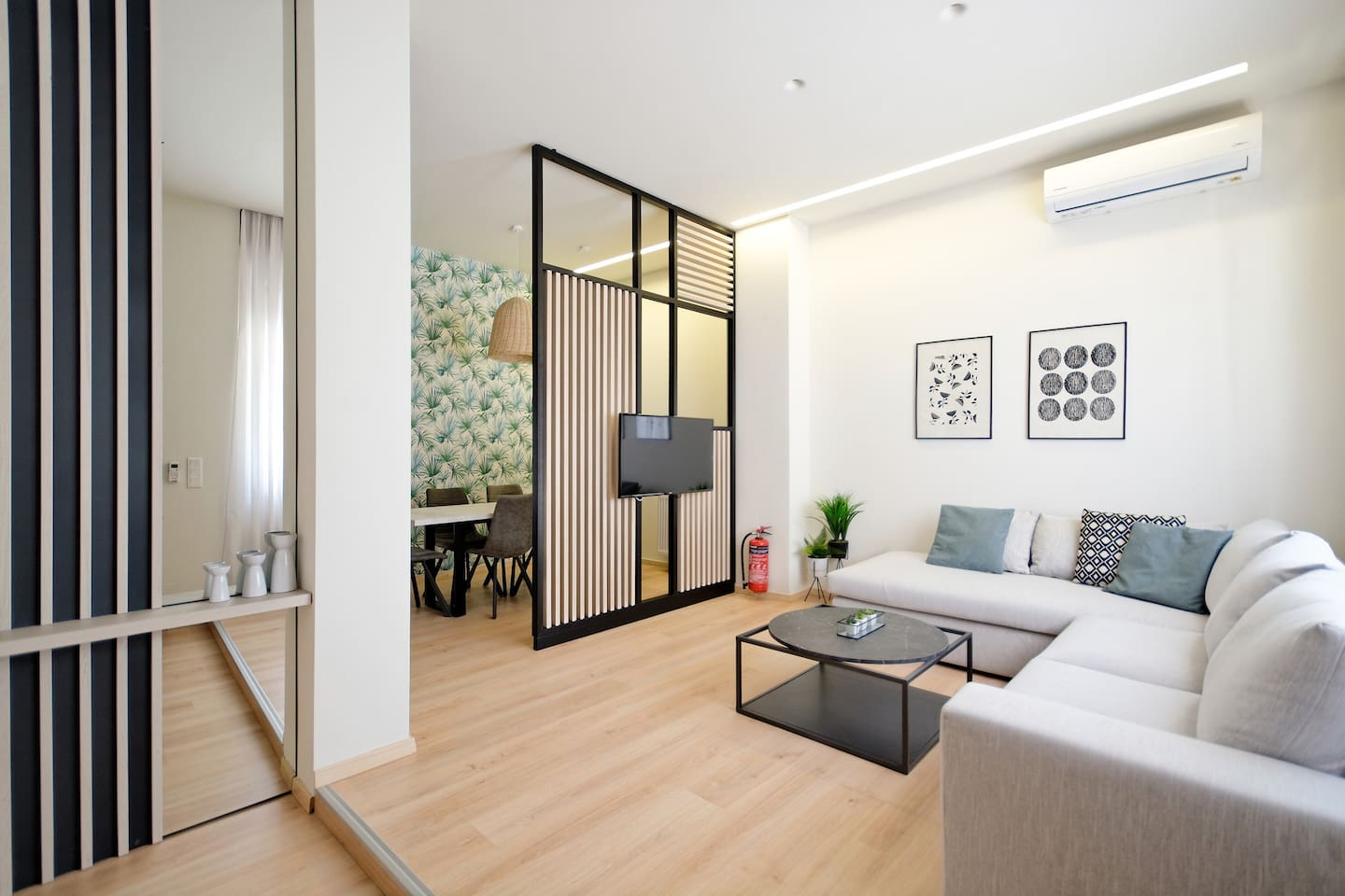 1.Welcome to Ourania! By the entrance of the apartment you will find a spacious living  area with a big corner sofa, a smart TV (Netfix ready) and a/c