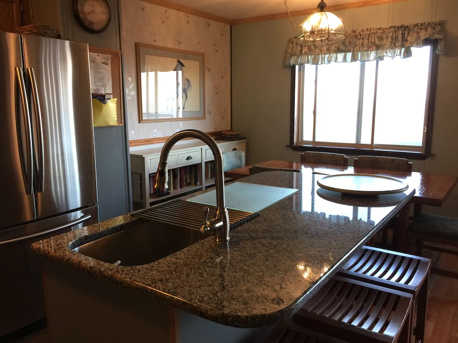 A granite counter with space for laptops or eating!  The sink is huge!