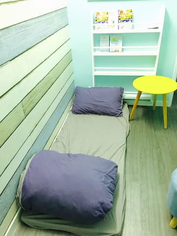 Bed On The Floor At Sitting Room Apartments For Rent