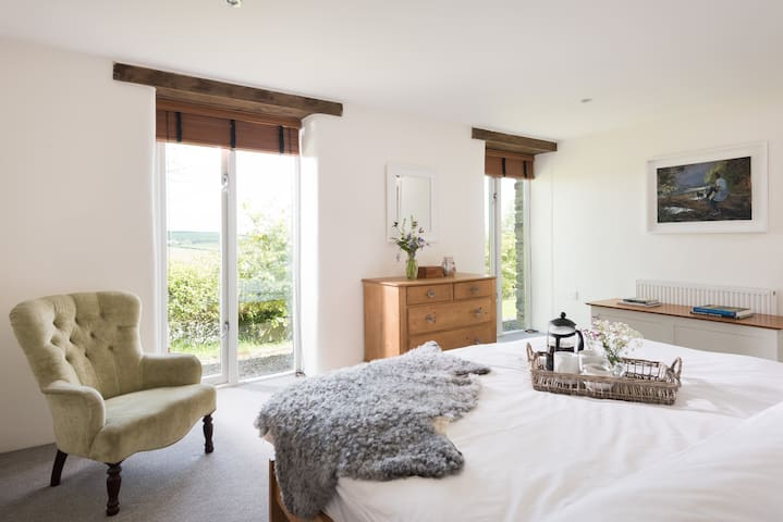 Our master bedroom is en suite, has a very comfortable super king size bed and enjoys lovely country views.