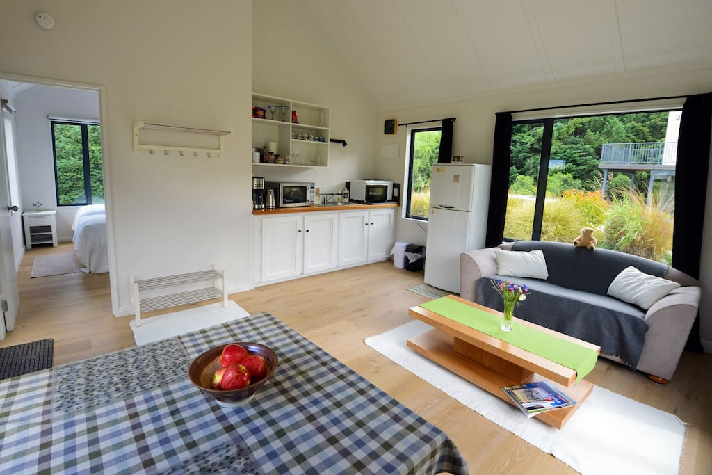 iki Lodge Cottage kitchenette and living space