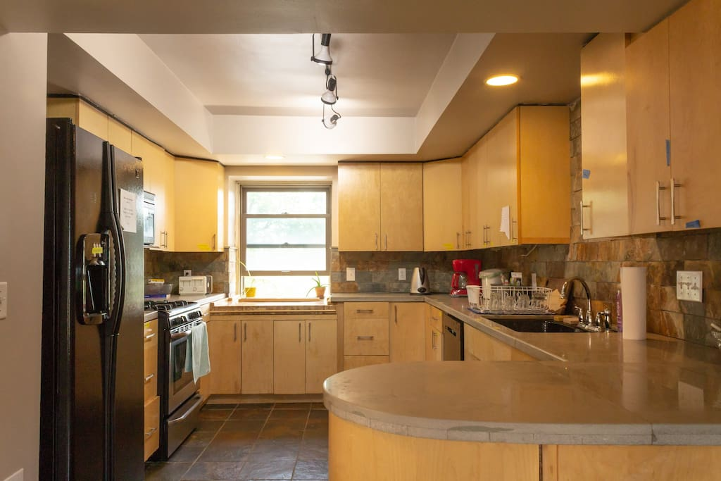 The shared kitchen with ample space for personal food storage.