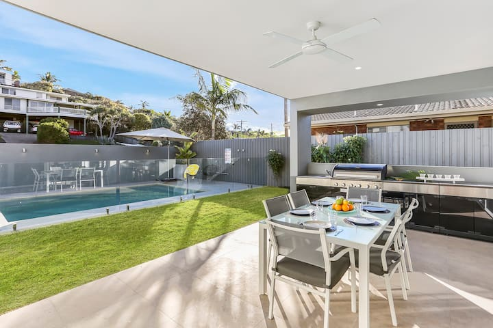 Sit back and enjoy a family BBQ while the kids are still swimming in the pool