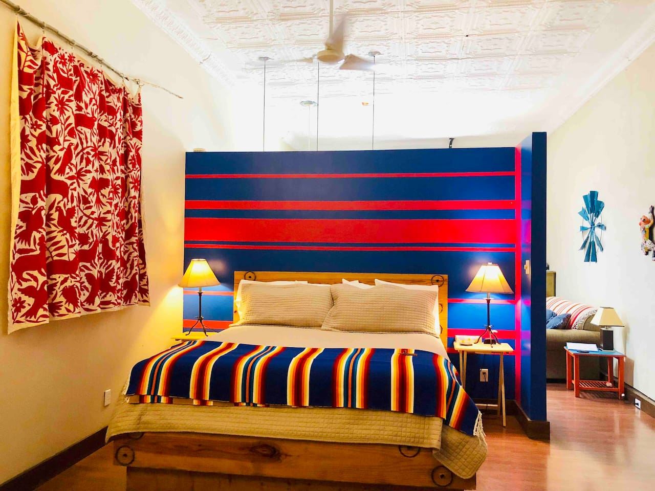 Sleep in a king sized bed in the Mexico inspired Loft 2!