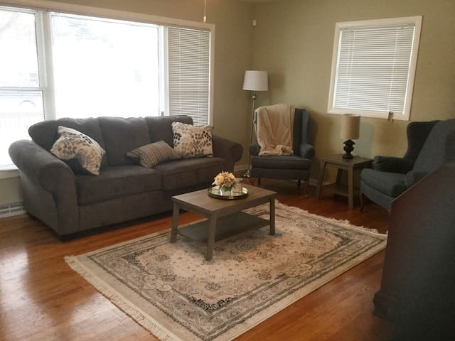 Super comfy living room with new sleeper sofa, fashionable artwork and furnishings!