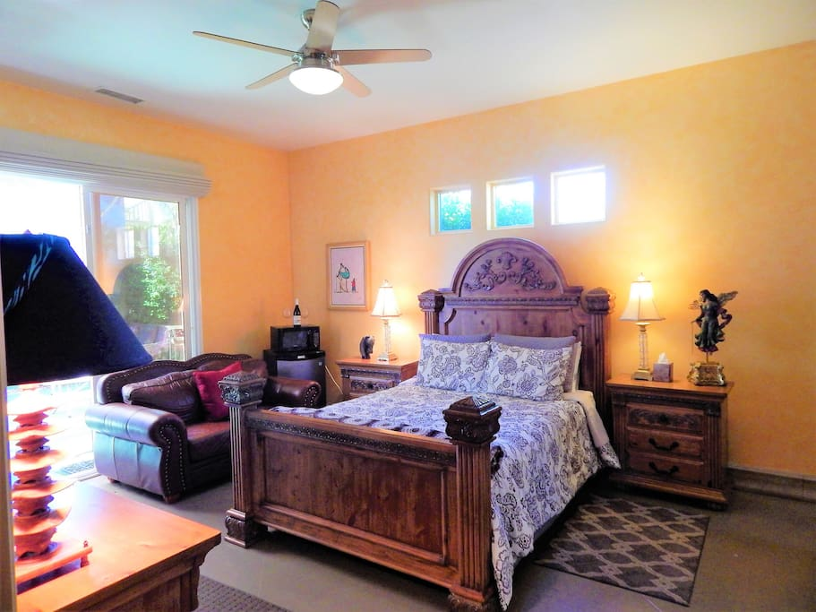 Spacious suite with Queen size bed, microwave, mini fridge and pool safe wine glasses.