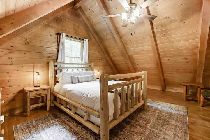 The large loft bedroom has a queen bed and ample storage space in the double dresser.  There is also a crawl space to store any luggage. To help make travel with kids easier, we have a pack n play and baby gates available for use if needed.