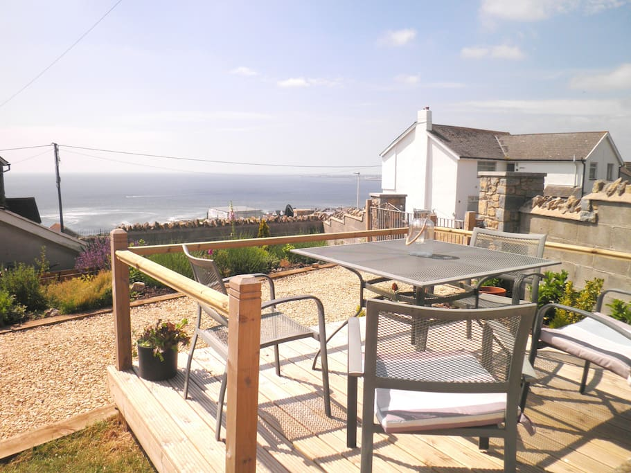 Enjoy alfresco meals from the front deck overlooking the sea. Walk 2 mins to our lovely village shop to pick up essentials or dine at the local restaurant