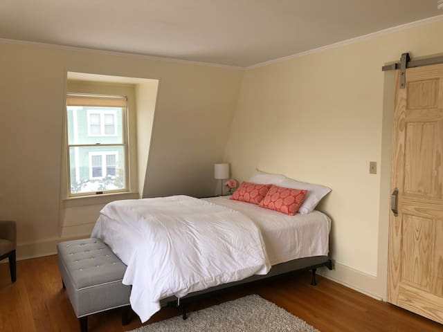 Largest bedroom has sitting area with chaise lounge, bay window, and big closet. Sliding barn door provides modern but authentic detail. Bright and contemporary throughout the home.