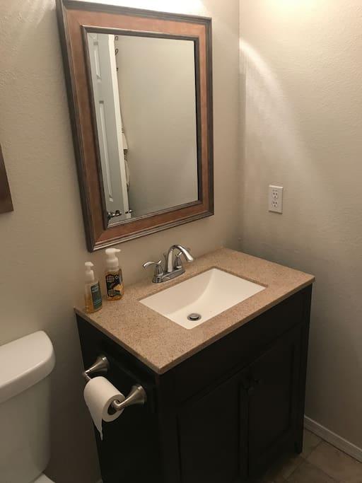 Hallway bathroom shared by 2 bedrooms.