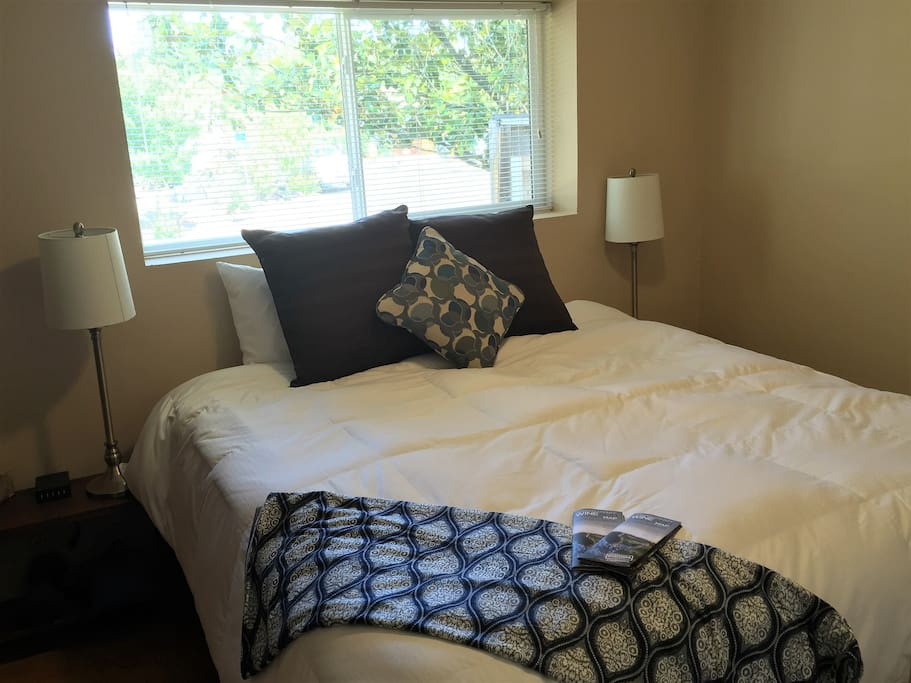 King size bed and closet and each bedside table has multiple AC outlets and USB charging ports