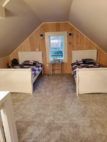 Upstairs bedroom/bunk/lounge area. This is a shared common area, not a room with door. Great for kids!