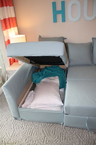 For the sofa bed bedding, simply lift the chase lounge piece up.