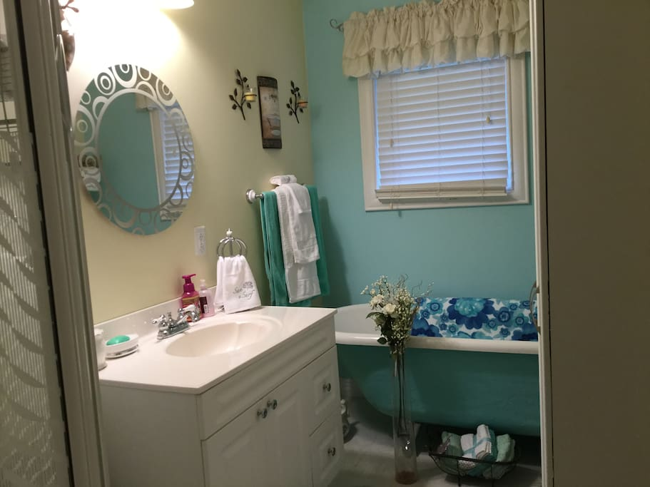 Bathroom has walk in shower and bathtub