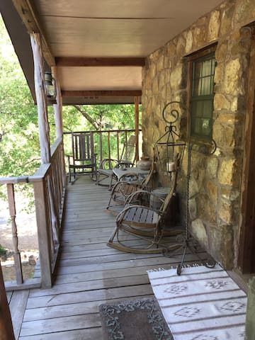 Rock your troubles away on this tree house inspired porch!