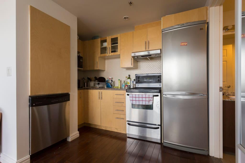 Fully-equipped kitchen - dishwasher, oven, fridge, plates, utensils, and pots and pans